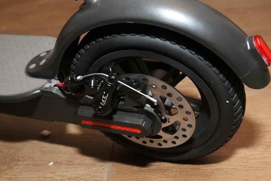 The disc brake on the back wheel.