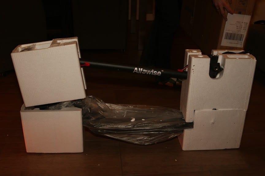 Alfawise M1 scooter in styrofoam